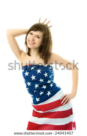 playful girl wrapped into the American flag making a crown with her fingers and pretending she is the Statue of Liberty - stock photo