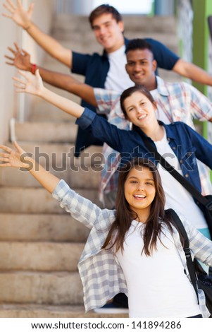 playful group of high school students waving hands - stock photo