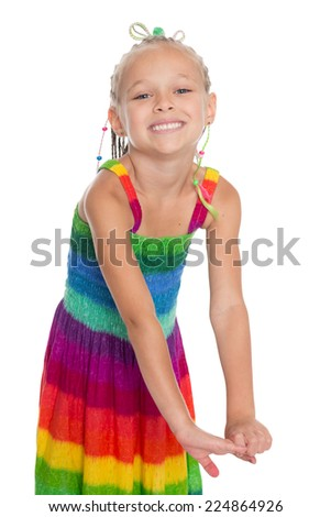 Playful little beautiful girl on a white. Girl is six years old. - stock photo