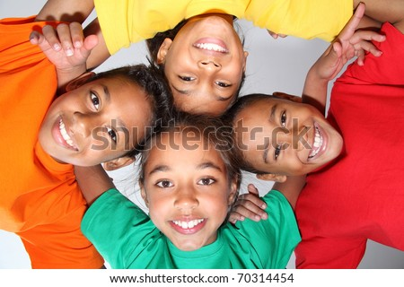 Playful school friends together in huddle - stock photo