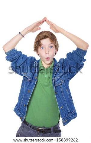 playful teenage boy makes strange gestures, isolated on white. - stock photo
