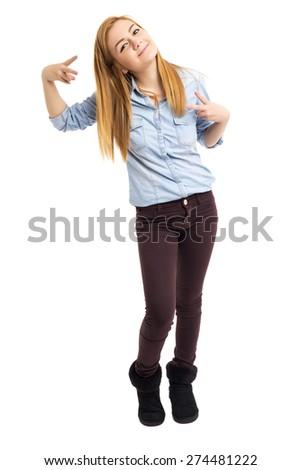 Playful  teenage girl making v sign over white background - stock photo