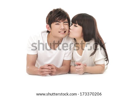 Playful young couple on white