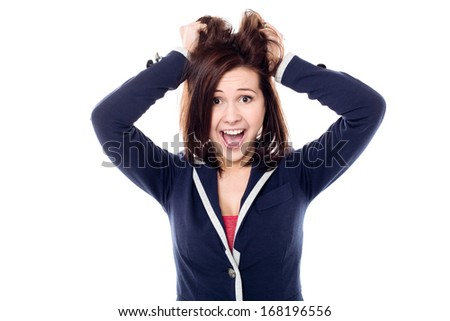 Playful young female pulling her hair out in madness - stock photo
