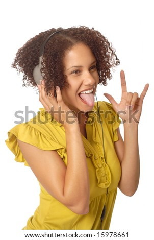 Playful young woman listening to music - stock photo