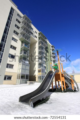 Playground among tall buildings - stock photo