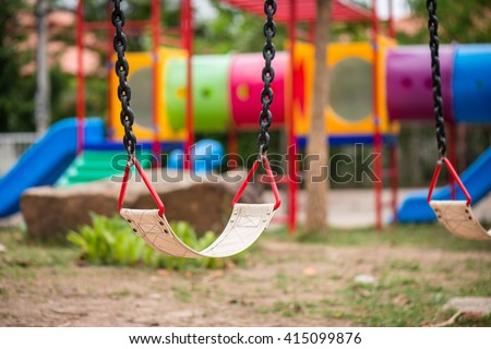 Playground and swings in colorful park - stock photo