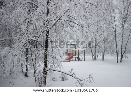 Playground filled by snow at winter