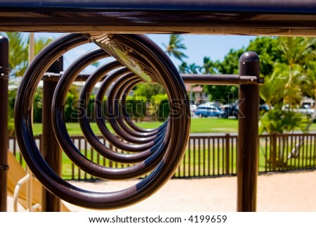 Playground monkey bar rings hanging down in a row