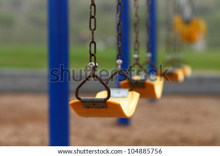 Playground swing set (selective focus) - stock photo