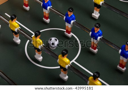 Playing a table soccer - stock photo