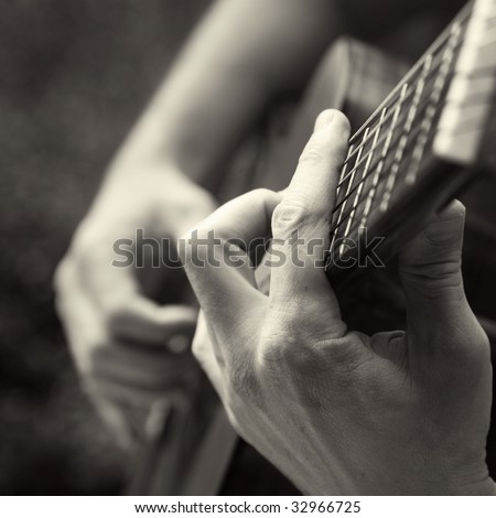 playing acoustic guitar, barre chord, - stock photo