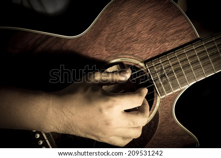 Playing acoustic guitar,guitarist or musician. - stock photo