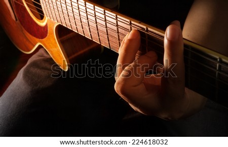 Playing acoustic guitar,guitarist or musician - stock photo