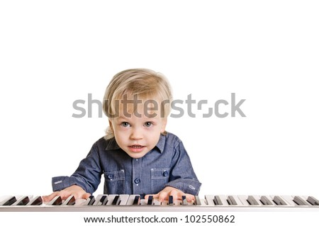 playing and singing little boy on white background - stock photo