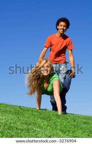 playing at  wheelbarrow races - stock photo