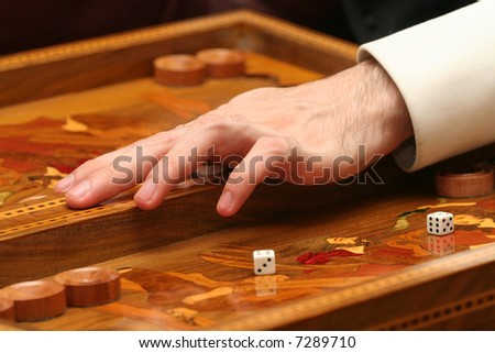 playing backgammon - focus on the hand - stock photo