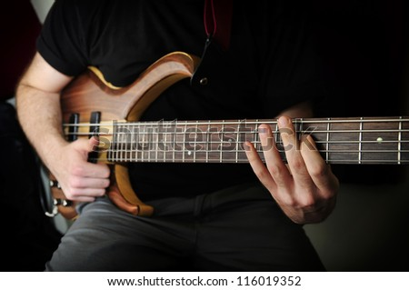 Playing Bass Guitar