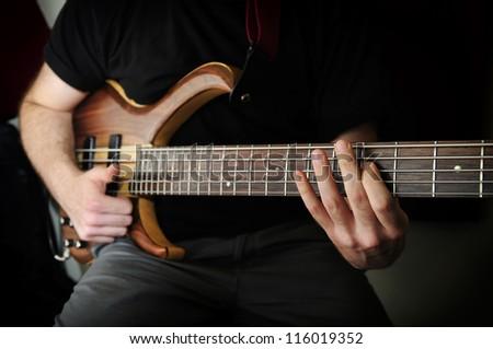 Playing Bass Guitar - stock photo