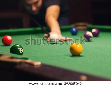 Playing billiard - Close-up shot of a man playing billiard - stock photo