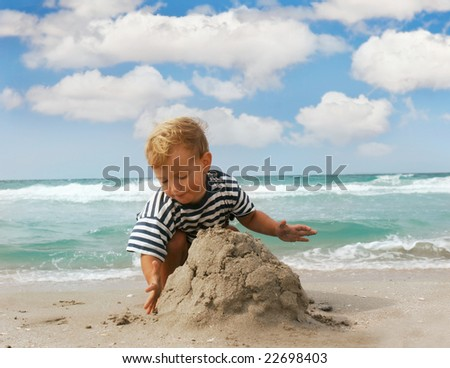 playing boy on beach