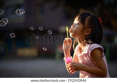 playing bubble wand - stock photo
