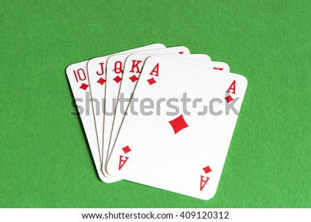 Playing card on green table, Straight flush