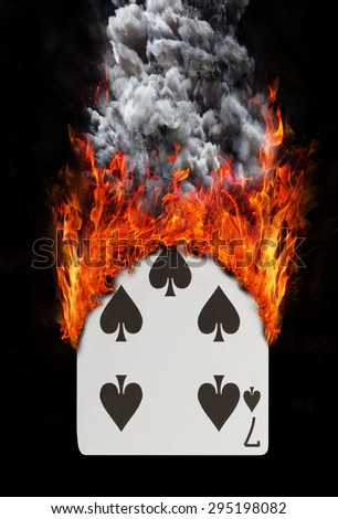 Playing card with fire and smoke, isolated on white - Seven of spades - stock photo