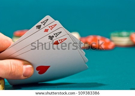 playing cards in a people hand - stock photo