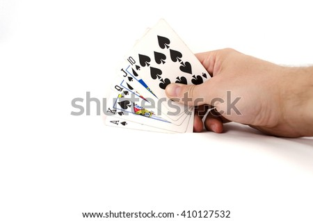 Playing cards in hand isolated on white background - stock photo