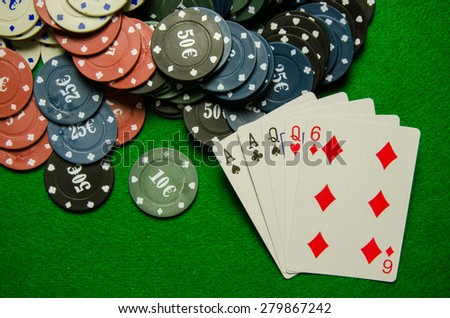 Playing cards 'Two pair' and chips on green background