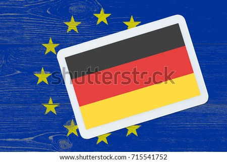 playing cards with back side germany flag on eu colors painted table, political relationship concept