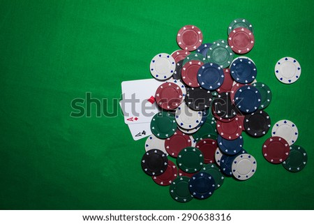 playing cards with chips on a green table