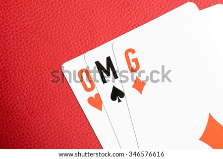 "Playing cards with ""OMG"" text - stock photo"