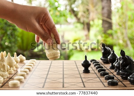 Playing chess game. defeating the opposite team. - stock photo