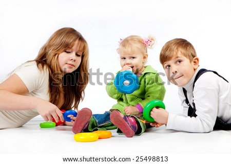 Playing children of mixed age on white - stock photo
