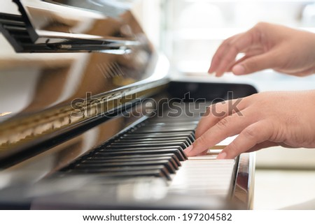Playing classic piano - stock photo
