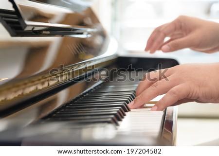 Playing classic piano - stock photo