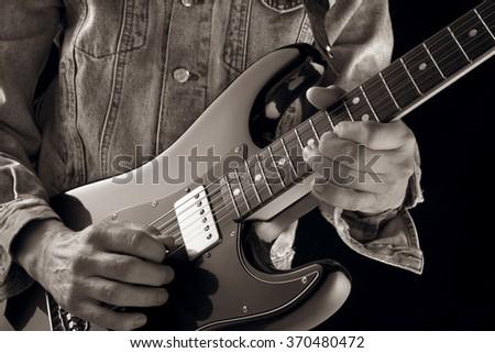 playing country music with vintage electric guitar