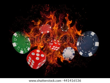 Playing dices and casino chips on fire. poker concept. - stock photo