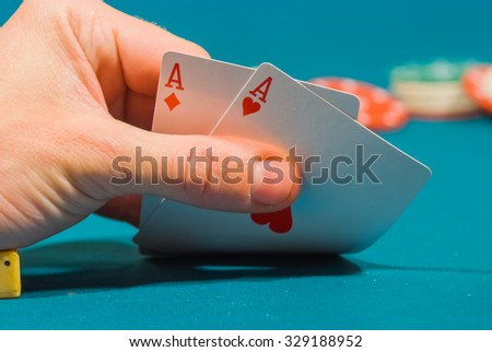 playing dices and chips on a green felt - stock photo