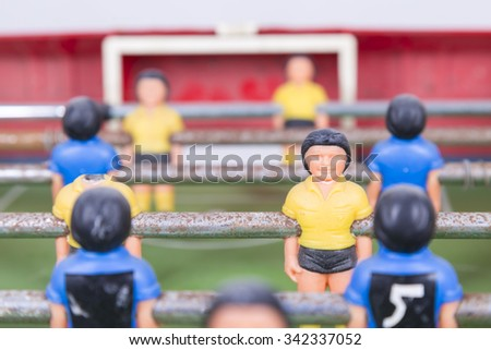 playing foosball  - stock photo