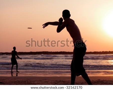 Playing Frisbee on Beach, Tel Aviv - stock photo