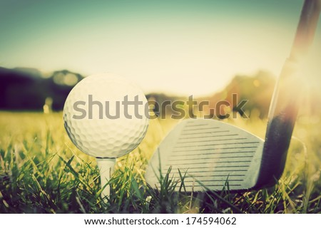 Playing golf, ball on tee and golf club about to shot. Vintage, retro style - stock photo