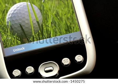 Playing Golf on PDA - stock photo