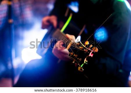 Playing guitar - stock photo