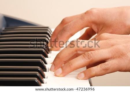 Playing keyboard - stock photo
