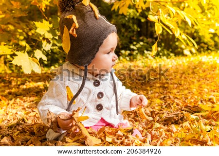 playing little cute toddler enjoying warmer sunny day - stock photo