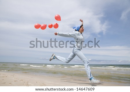 Playing on the beach. - stock photo