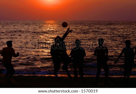 Playing on the beach (Goa, India). - stock photo